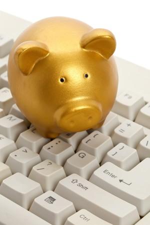 Golden Piggy Bank and computer keyboard photo