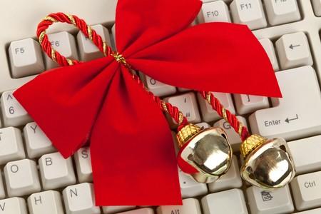 Christmas Bells, ribbon and computer keyboard photo