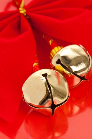 christmas bells: Christmas Bells and ribbon with red background
