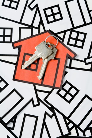 Key and a home sign, Real Estate Concept  photo