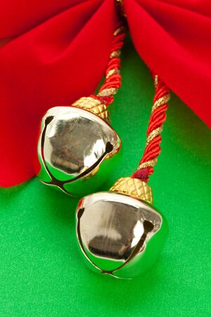 christmas bells: Christmas Bells and ribbon with green background