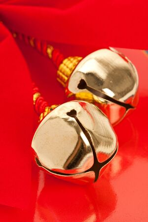 Christmas Bells and ribbon with red background