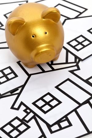 Golden Piggy Bank, Real Estate Concept photo