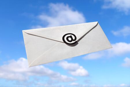 envelope: Blue sky and Envelope with @ Symbol, concept of E-Mail