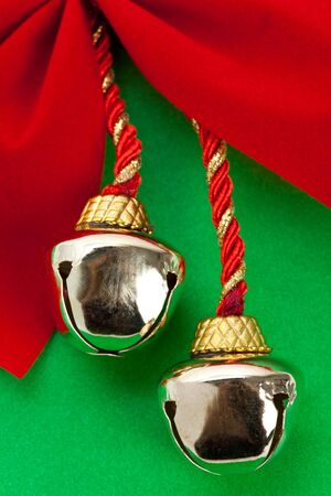 Christmas Bells and ribbon with green background