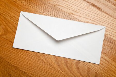 White Envelope on wood tabletop
