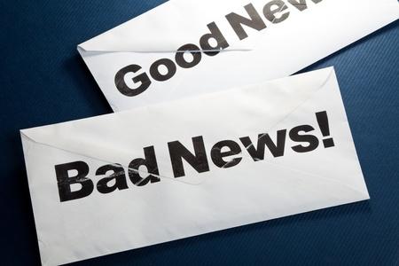 Goed nieuws en slecht nieuws, bedrijfs concept Stockfoto