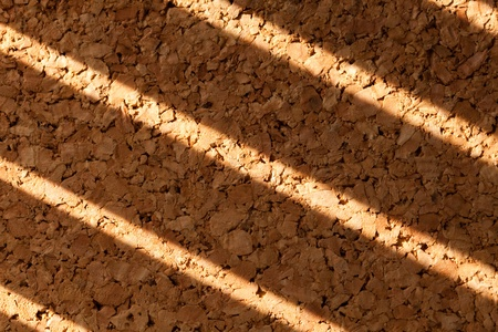 shutter: Corkboard with shutter shadow for background Stock Photo