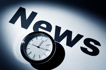 Clock and word of News for background   Stock Photo