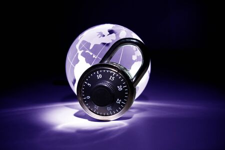 Globe and lock for background Stock Photo - 9206674