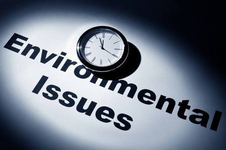 environmental issues: Clock and word of Environmental Issues for background