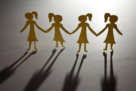 Paper Chain girls, concept of Teamwork photo