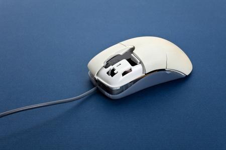 Broken computer mouse close up photo