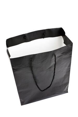 consumerism: Black Shopping Bag with white background Stock Photo