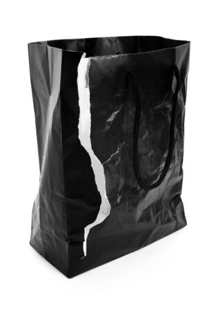 Torn Black Shopping Bag with white background Reklamní fotografie