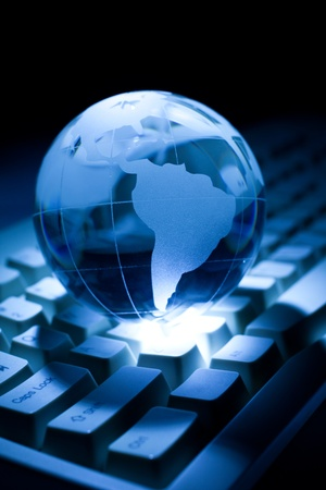 technology: Blue Globe and Computer Keyboard for background