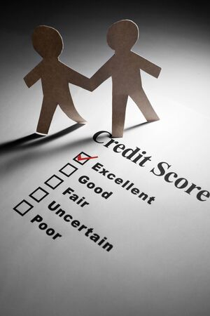 rating: Credit Report and Paper Chain People Stock Photo