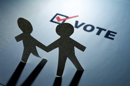 vote: vote and Paper Chain Men close up