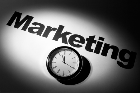 Clock and word of  Marketing for background