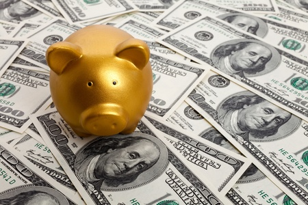 Piggy Bank and Hundred Dollar Bills for background photo