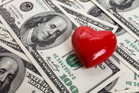 Red Heart and Hundred Dollar Bills for background photo