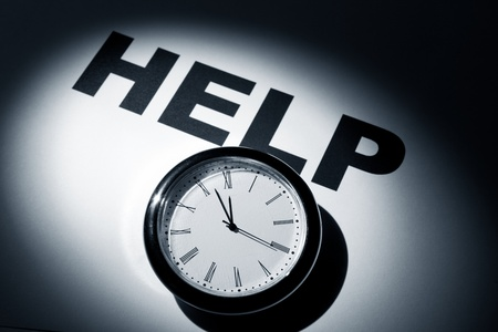 Clock and word, concept of Need Help   Stock Photo