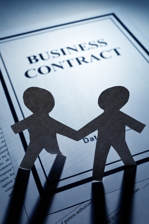 Business Contract and Paper Chain Men close up photo