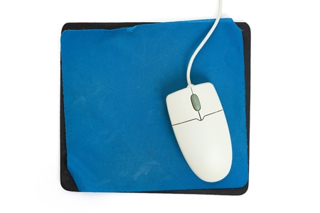 Computer Mouse and old Mouse pad close up