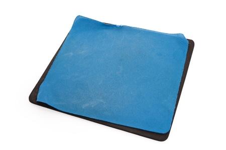 空白の古い青いマウス パッドをクローズ アップ 写真素材