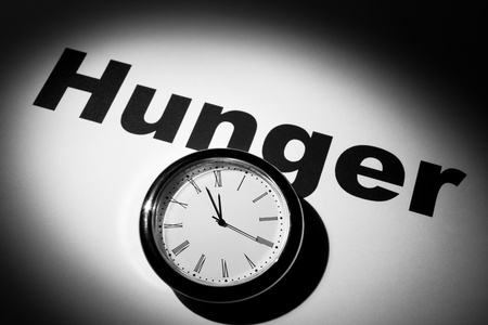Clock and word of Hunger for background