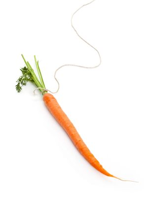 perks: String and carrot with white background