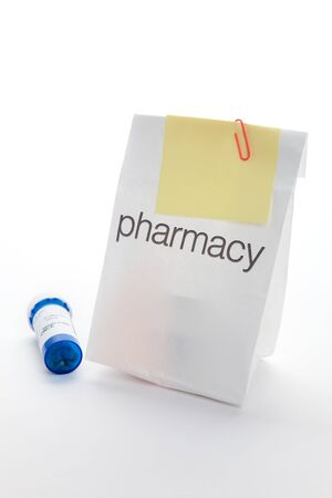 Pharmacy Bag and Note paper close up  photo