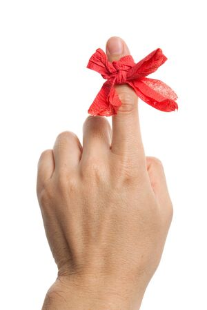 Red bow on finger close up photo