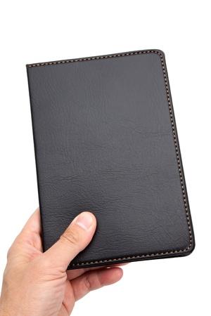 흰색 배경에 검은 색 가죽 노트북