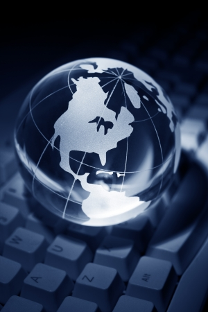 e business: Blue Globe and Computer Keyboard for background