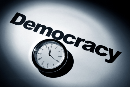 Clock and word of Democracy for background photo