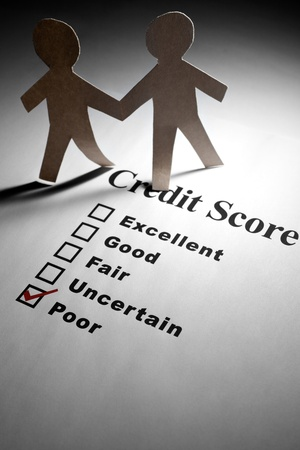 credit score: Credit Report and Paper Chain People Stock Photo