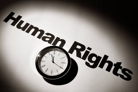 word: Clock and word of Human Rights for background