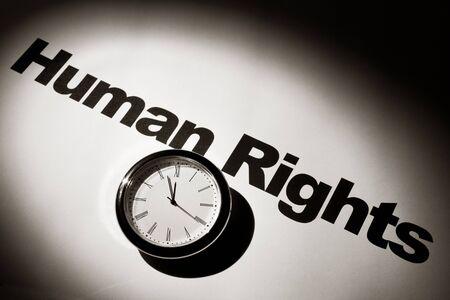 diritti umani: Orologio e parola dei diritti umani per sfondo   Archivio Fotografico