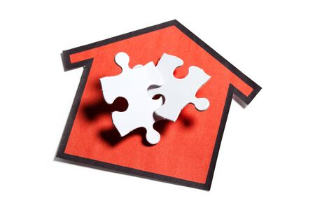 House sign and White Blank Puzzle, business concept  photo