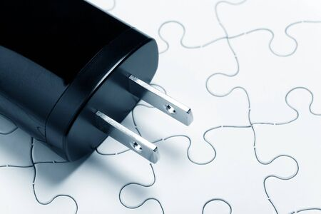 electric plug: black Electric Plug and puzzle, concept of Energy Conservation