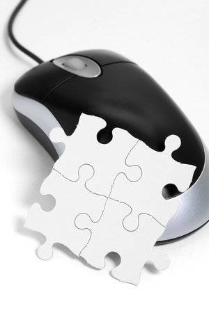 computer mouse and Puzzle, business concept  photo
