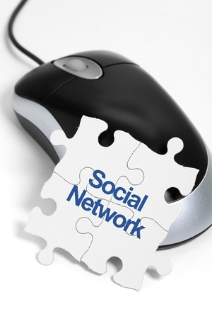 computer mouse and Puzzle, business concept of Social Network photo