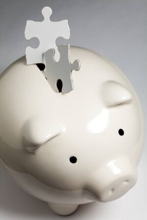 Piggy bank and Puzzle, business concept of Solution photo