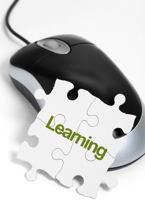 computer mouse and Puzzle, business concept of Learning photo