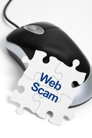 scam: computer mouse and Puzzle, business concept of Web Scam