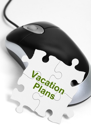 computer mouse and Puzzle, business concept of Vacation Plans photo