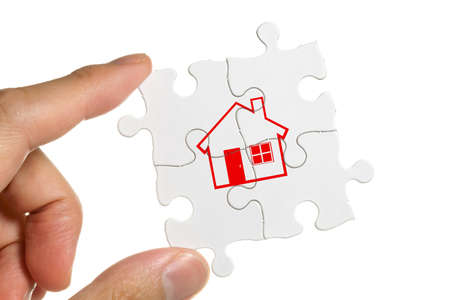 Puzzle and Home Sign, business concept  photo