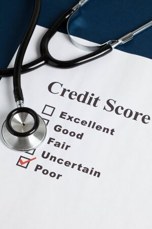 credit report: Stethoscope and Credit Report, concept of Credit Problems