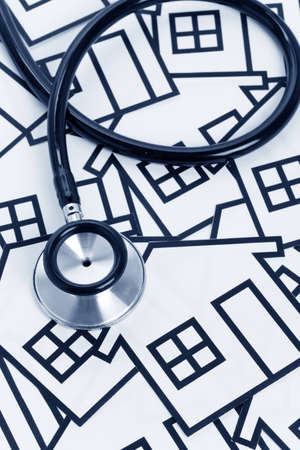 Stethoscope and House, concept of Real Estate Problems Stok Fotoğraf